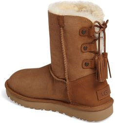 This iconic UGG boot is updated with a slimmer toe and laces at the back, making it easier to slip on and off.