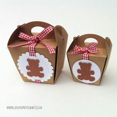 Gift boxes with teddy bear motifs and red gingham ribbons for a Teddy Bears' Picnic party!