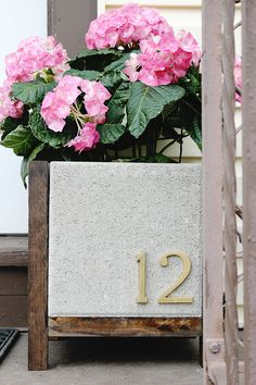I love this cute little planter! You can so easily place your house numbers here and not only have a great little plant, but a sweet modern planter as well.