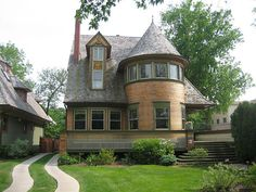 Frank Lloyd Wright: Walter Gale House, Oak Park area of Chicago, IL.  This home is often cited for the ribbon of art glass windows of rounded, turreted bay. When light reflects on the windows, they appear opaque, giving a sense of intimacy and privacy - themes of his work.