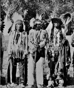 L-R: Wahbikewew or White Eagle (Cree), Moneghan (Cree), and Seeseebasquat or Sugar (Saulteaux) at Lebret, Saskatchewan - 1925