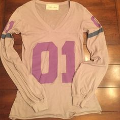 """Vintage Havana adorable long tee size small. This Vintage Havana long sleeve """"number 1"""" tee is so cute. The sleeves have a band at the wrist with gathering for a girly look. V neck with 01 in muted purple on the front and on each sleeve. Sleeve also has a muted blue stripe. 100% cotton. Was worn one time in excellent like new condition. Perfect with jeans or shorts. Vintage Havana Tops"""