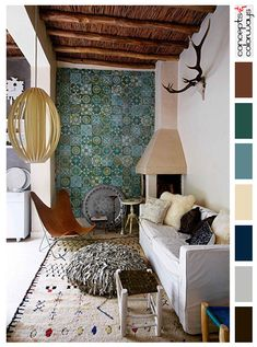 moroccan style living room interior with color palette, warm brown, reddish-brown, warm white, teal green, blue-green, blonde wood, dark navy blue, warm gray, warm black