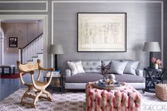 In the family room, the custom sofa is flanked by lamps by Lucca Studio, and the round iron table is from Lillian August; the carved wood chair is vintage, the Filicia-designed ottoman is upholstered in a Kravet wool, and the walls are covered in a grass cloth by Phillip Jeffries. Style At Home, Elle Decor, Living Room Designs, Living Spaces, Living Rooms, American Interior, Design Salon, Family Room Design, Family Rooms