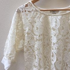 Lace Top Cream colored lace top with banded 3/4 sleeves.  In excellent condition.  Will also fit an XS. Forever 21 Tops