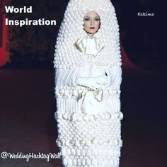 Well this is different! Eskimo wedding? Not quite .. but youd think!  Its Yves Saint Laurent's knitted cocoon gown!  Every wedding unique!  At  Wedding HashTag Wall - were about creating a wall of memories from all your friends and family from around the world.  Get your free trial at our website.