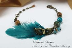 Love the feather, bead combination. Maybe add mini peacock feathers...