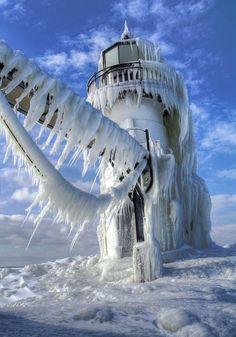A Lake Michigan lighthouse takes the brunt of a frigid winter in Saint Joseph, Michigan.