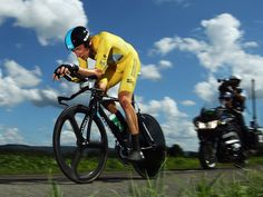 Great Britain s Bradley Wiggins wins the stage nine time trial to  strengthen his grip on the Tour de France race leader s yellow jersey. f198baf1c