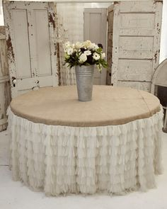 Always love round tables even though I do not own one!!! Love the ruffles with the burlap.