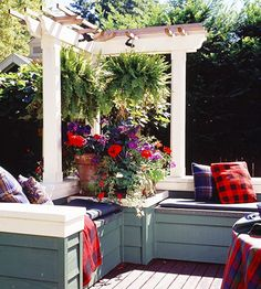 Small Pergola  A pergola needn't be large or ornate to function as a design element. Relatively small in scale, this structure adds class to a corner of the deck.