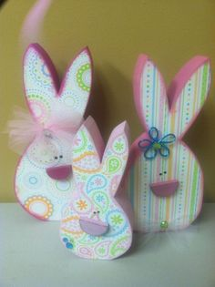 These are wood, but there must be some way to make these from paper.  super cute