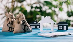 Selective Focus Paper Houses Moneybags Dollar Signs Wooden Desk Mortgage Stock P , Refinance Mortgage, Mortgage Payment, Sell My House, Selling Your House, Renting Out A Room, Sell Textbooks, Debt To Income Ratio, Cash From Home, Monthly Expenses