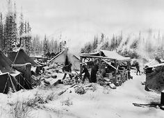 1942. A soldier construction camp with sawmill along the ALCAN highway route. The road was originally constructed by the U.S. Army Corps of Engineers with the support of more than 10,000 soldiers. After the initial pioneer road was constructed the project was turned over to the U.S. Public Roads Administration who hired private contractors to complete the road and upgrade the temporary bridges with permanent ones.