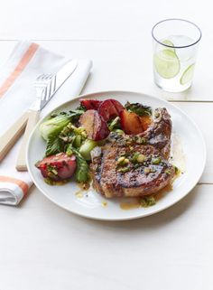 Grilled Pork Chops with Plum and Bok Choy: Juicy plums lend sweetness to this savory supper. Click through to discover more heart-healthy dinner recipes that are easy to make.