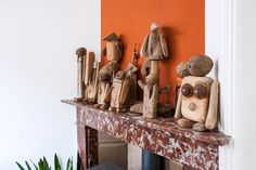 She loves creating these driftwood sculptures. Left and right a coconut is incorporated.