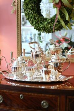 Cary Nichols Christmas Home Tour with a Touch of Glamour : Boxwood Wreath on Mirror above Silver Service