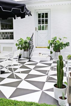 Jazz up a dull concrete patio with some paint and a graphic pattern. Click for A Beautiful Mess' DIY tutorial.