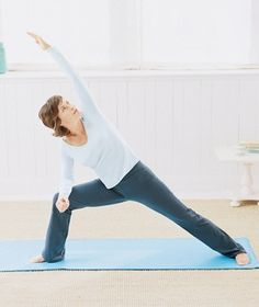 How to do a beginner's yoga workout (Shown: Extended Side Angle pose)