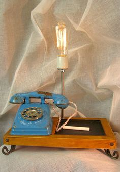 This nostalgic toy phone has been repurposed into a funky table lamp. Unique Lamps, Unique Lighting, Cardboard Shipping Boxes, Thrift Store Crafts, Old Phone, Lamp Design, Ring Ring, Repurposed, Kids Room