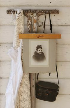 <3 - old pant hanger is perfect for displaying old photos!