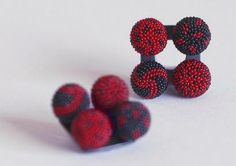 An interesting pair of red & black earrings by Stephan Hampala ~ I just love the patterns on these gorgeous little balls!