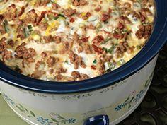 Crockpot Breakfast Casserole (frozen hash browns, suasage, mozzarella, perm, sun-dried tomatoes, green onions, eggs, milk, salt, pepper)