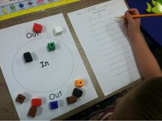 "my favorite addition math stations. This one is called ""in and out"". The students simply drop a handful of cubes onto the in and out board. They record the number in the circle for the first addend and the cubes outside of the circle as the 2nd addend. Then solve the number sentence. The kids really like it!"