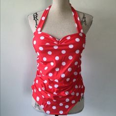 "Pinup rockabilly halter one piece polka dot Pinup rockabilly halter one piece polka dot New SZ XXL (fits XL). Red with white polka dots, slightly padded cups. Halter tie at neck.  One piece.  Tag size is XXL but runs smaller. Would fit Size Large to XL.  Bust measures 34"" to 39"" stretched. Waist 34"".    #rockabilly #retro #pinup #polkadot #onepiece #swimsuit Fashion sport Swim One Pieces"