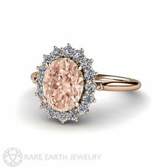 An absolutely stunning natural Morganite and diamond ring in your choice of 18K White, Yellow or Rose Gold. At the center is a lovely 1.75ct oval