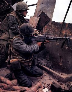 U.S Marines returning fire in Hue, Vietnam, Feb 1968, during the Tet offensive. The offensive was a crushing military defeat for the VC and their North Vietnamese allies. US mass media coverage of the battles, however, shocked US public opinion to such a degree that, from that point on, the war was a politically lost case.