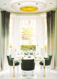 dark green dining chairs + soft velvet drapes
