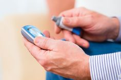 man checks blood sugar levels after taking metformin