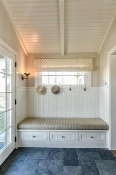 A perfect spot between outdoors and in, this mudroom provides a bright place to put on and remove shoes (which can be stashed in the drawers below) and hang a hat, coat or towel. The slate floor hides dirt well and is easy to clean — perfect for the inevitable messes.
