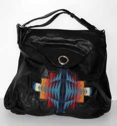 Black high shoulder purse with a touch of Pendleton, by Tammy Beauvais