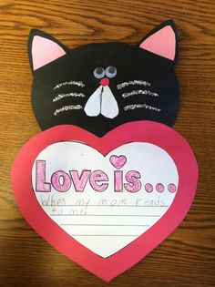 A Cupcake for the Teacher blog- Love is. . . kitty for Valentine's Day ( bulletin board or door idea)