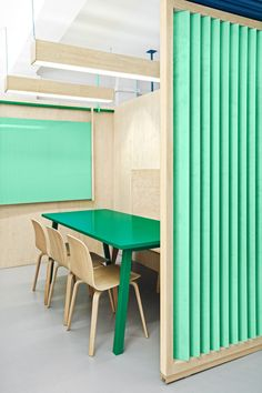 Masquespacio Renovates a Language Center near Barcelona Masquespacio paired Studio Tolvanen chairs with a custom painted plywood table in a classroom at the Academia Altimira in Cerdanyola del Valles, Spain. Design Commercial, Commercial Interiors, Contemporary Interior Design, Interior Design Living Room, Plywood Interior, Interior Paint, Plywood Table, Workspace Design, Design Offices