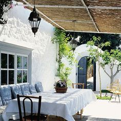 A timber frame roof provides a place to natural materials that will provide plenty of shade during the hottest part of the day but won't block out too much light. http://www.easydiy.co.za/index.php/garden/479-the-shady-side-of-summer