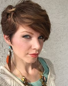 Textured pixie cut, feather earrings.