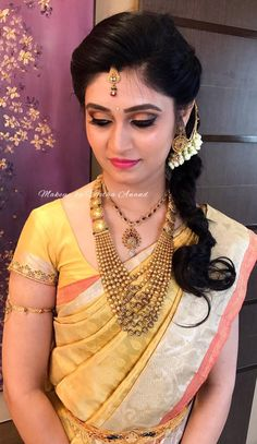 Pavithra looks clean, fresh and gorgeous for her engagement. Makeup and hairstyle by Vejetha for Swank Studio. Coral lips. Loose fishtail braid. Antique gold jewellery. South Indian bride. Eye makeup. Bridal jewelry. Bridal hair. Silk sari. Bridal Saree Blouse Design. Indian Bridal Makeup. Indian Bride. Gold Jewellery. Statement Blouse. Tamil bride. Telugu bride. Kannada bride. Hindu bride. Malayalee bride. Find us at https://www.facebook.com/SwankStudioBangalore