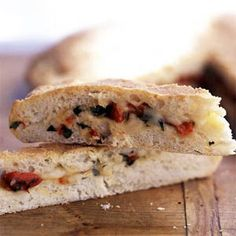 Fontina & Red Pepper-Stuffed Garlic Focaccia ~ Oven-roasted garlic is tucked into a homemade yeast dough with nutty fontina cheese and bottled bell peppers to make a colorful filled foccacia bread. For variety, try the foccacia with other types of cheese, such as provolone, asiago, or parmesan.