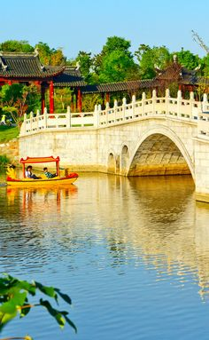 Suzhou gardens, under the blue sky bridges and lakes. | Amazing Photography Of Cities and Famous Landmarks From Around The World- #LadyLuxuryDesigns