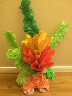 Seaweed-Tissue paper, duct tape and wire hanger. Paper cones on a stick, coral- dyed coffee filters and bath sponges