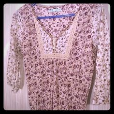 Maurice's flowered blouse Super cute cream and purple flower blouse. Perfect for spring. 3/4 sleeve length. Smoke free home. Maurices Tops Blouses