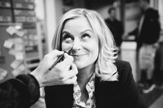"""Amy's prosthetic nose is applied by Ian Sommerholder [off camera],"" says Amy Poehler."