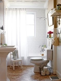 This reminds me of your bathroom. I like the ceiling tile and large molding. Also like the shelves.