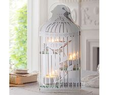 Glass Birdcage Tealight Holder is beautifully mirrowed
