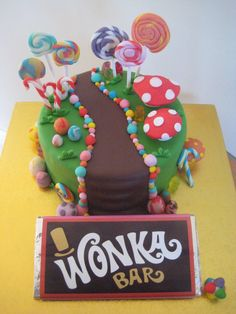 Willy Wonka Cake complete with chocolate river and Wonka bar I want this for my birthday lol