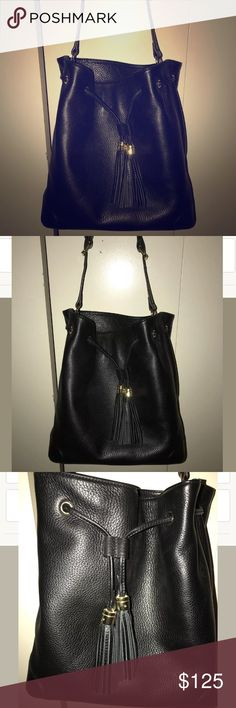 Gorgeous Black leather bucket drawstring Bag Beautiful real leather Bucket bag in Terrific condition!!  Straps In excellent condition. No dust bag. Don't miss out! 😄chain NOT included. Took it from another purse. Isaac Mizrahi Bags