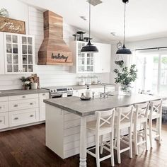 Love the ship lap on island and wall to match... love the white cabinets and grey countertop but would like black knobs instead of silver